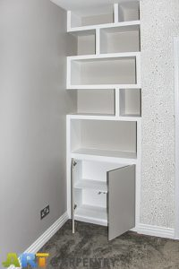 Contemporary style alcove bookshelves with cupboard, built in and hand painted in estate eggshell