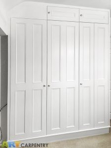 Bi-fold doors traditional style fitted wardrobe
