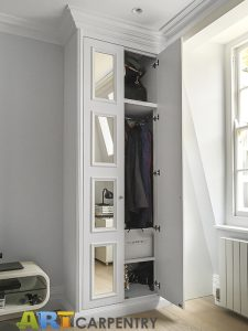 A gorgeous wardrobe with mirrored doors