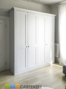 Shaker style fitted living room wardrobe