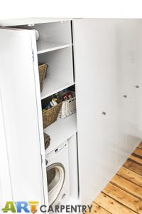 Laundry wardrobe with bi-folding doors. Includes space for laundry, washing machine, dryer, boiler and ect.