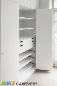 Bi-folded Doors Huge Contemporary Style Fitted Wardrobe.