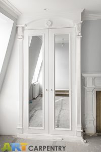 A gorgeous wardrobe with nice wood-carved corbels and French rosette